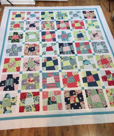 Wonky 9 Patch Tutorial featured by top US quilting blog and shop, Seams Like a Dream Quilt Designs: Wonky 9 patch quilt top