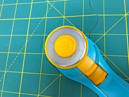 Exploring Quilting Basics: 4 Fabric Cutting Prep Tips featured by top US sewing and quilting blog, Seams Like a Dream: rotary cutter
